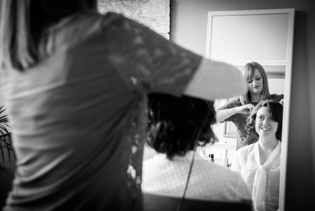 bride having her hair done at home
