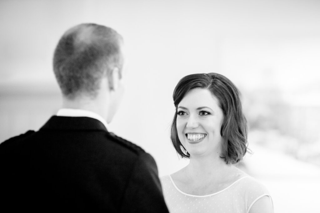 Bride smiling during the vows
