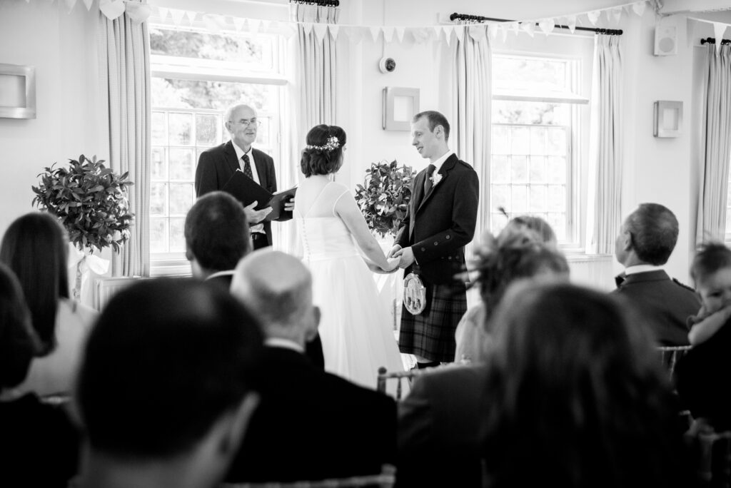 Bride and groom exchanging vows at Quarry Bank Mill