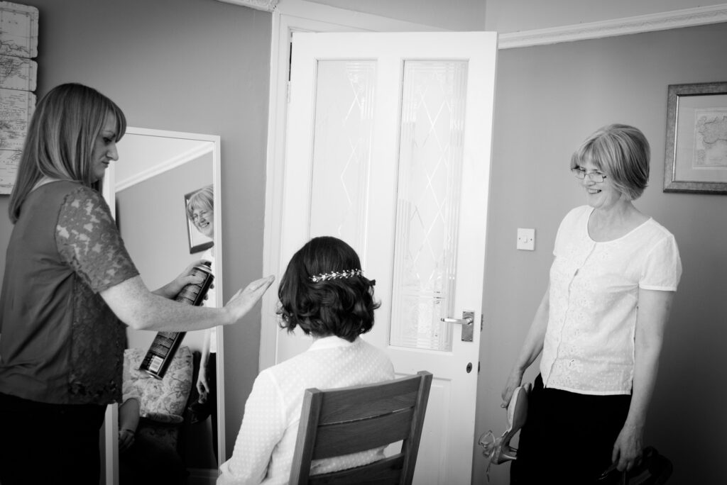 mum sees the bride having her hair done