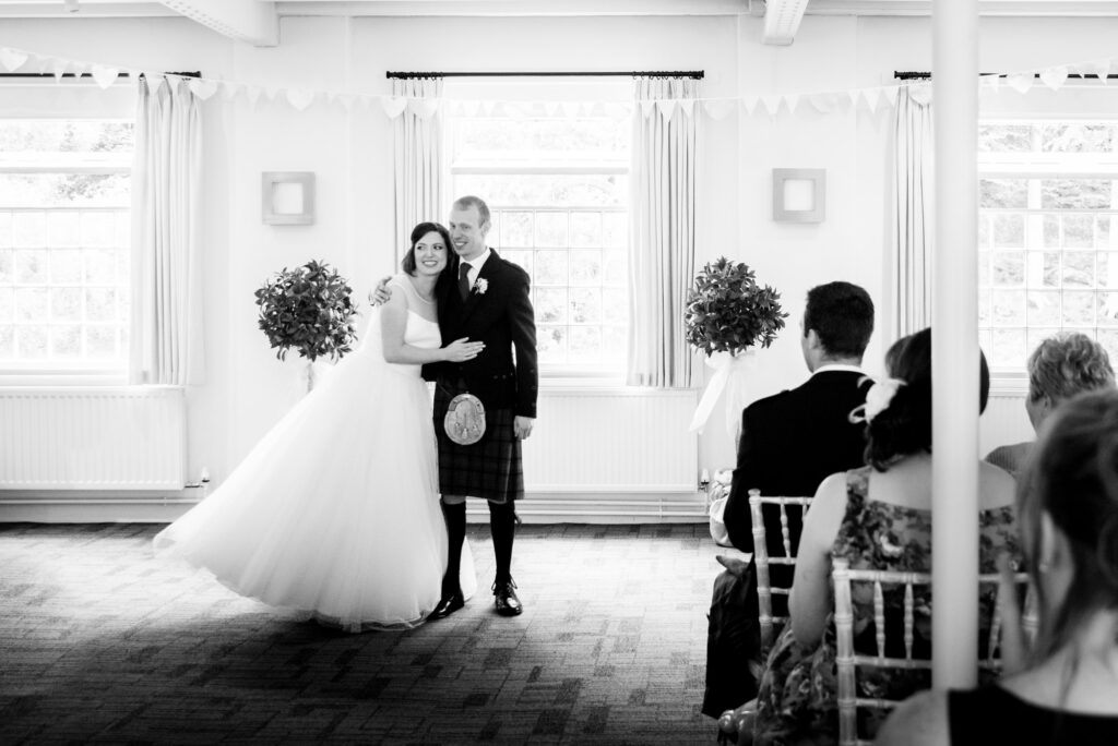 Bride and groom walking down the aisle at Quarry Bank Mill