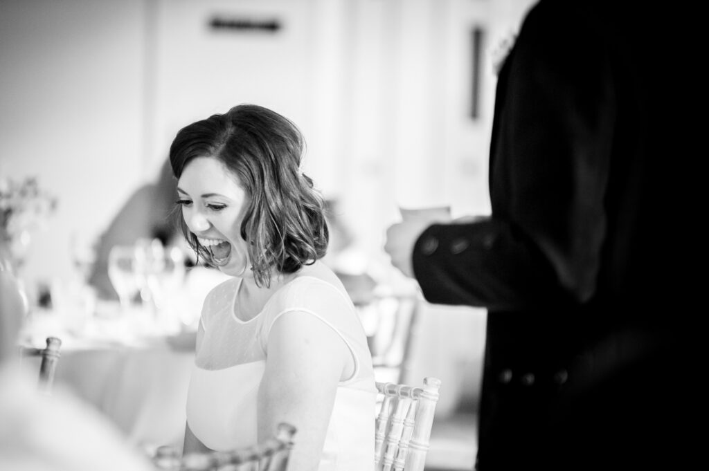 Bride laughing at the speeches