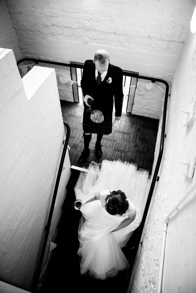 bride and groom going down the stairs at Quarry Bank Mill