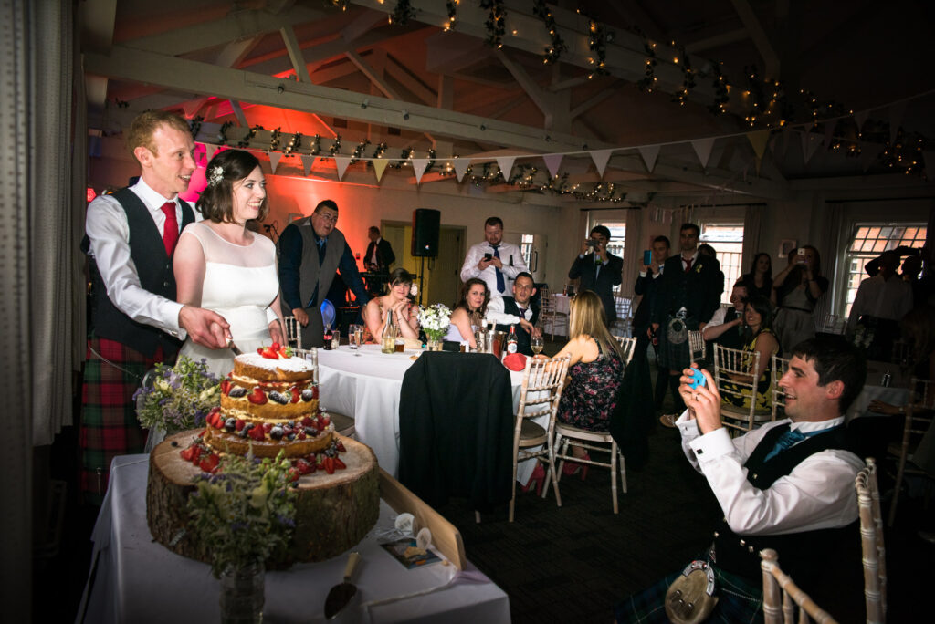 Cutting the semi naked cake at Quarry Bank Mill