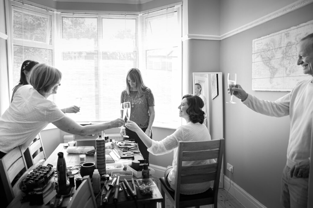 bride and her family toasting at the bridal prep