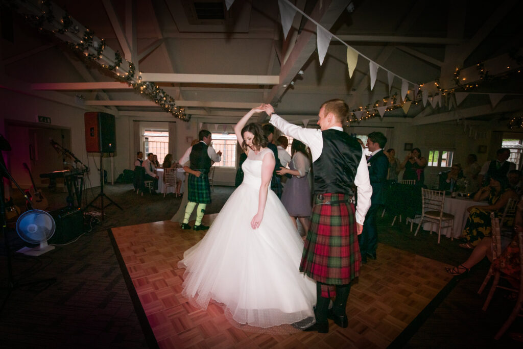 Bride and groom dancing at Quarry Bank Mill