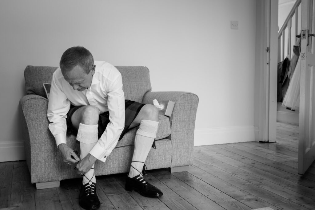 Scottish father of the bride getting ready