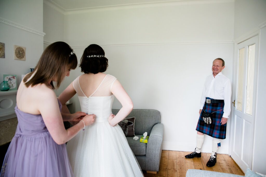 father of the bride sees the bride ready