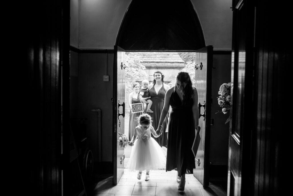 Bridal party entering St John the Baptist church in Heaton Mersey