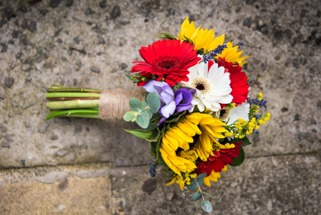Bridal bouquet with sunflowers red and white gerberas