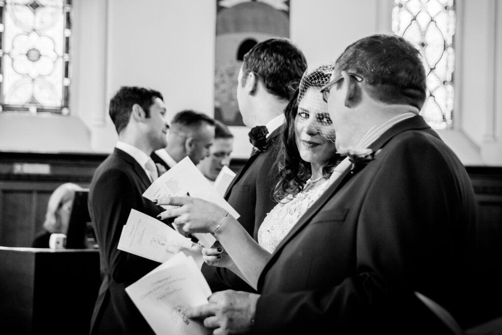 Bride singing hymns with her dad
