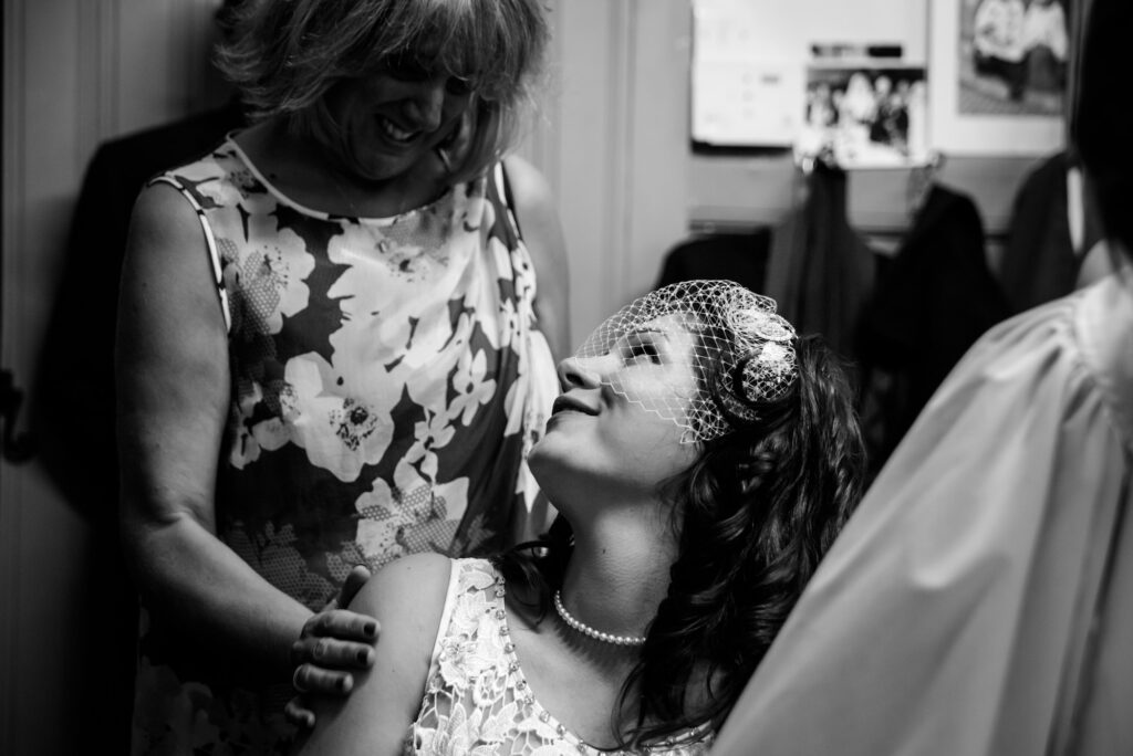 Bride and her mother looking at each other after signing the registry