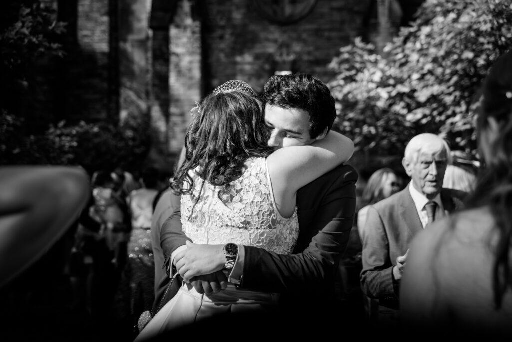Wedding guest hugging the bride