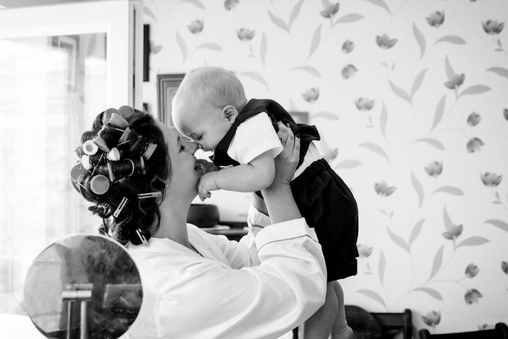 Bride cuddling her toddler son during the bridal prep