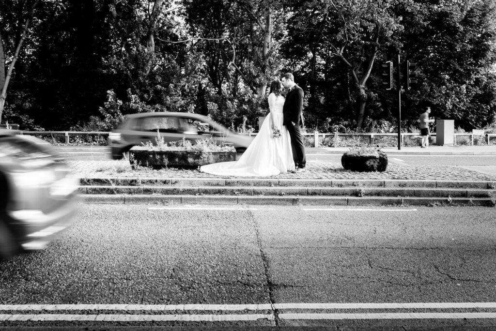 Bride and Groom Kissing in the middle of the road in Heaton Mersey
