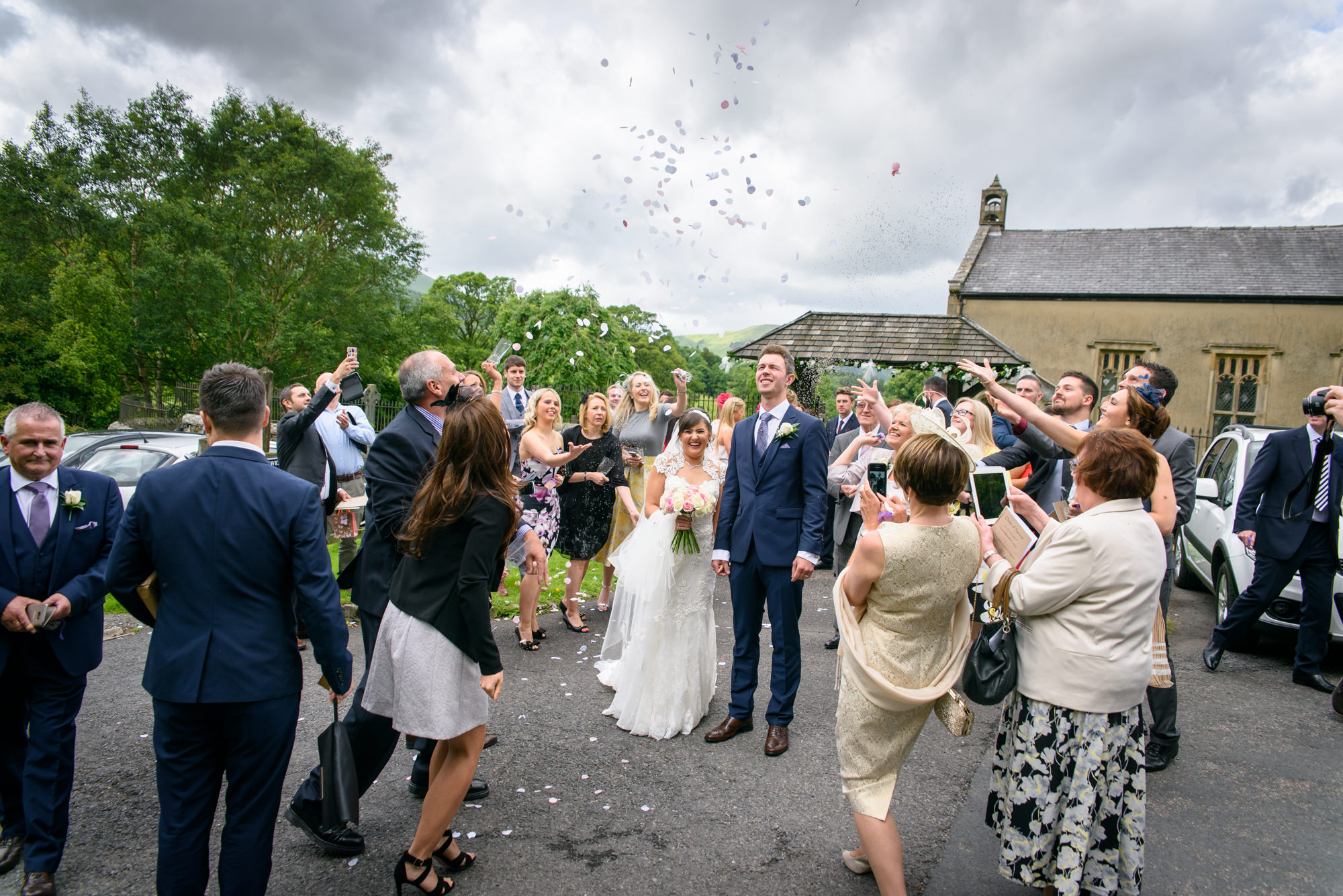 Throwing confetti outside the Parish Church of Saint Michael Whitewell