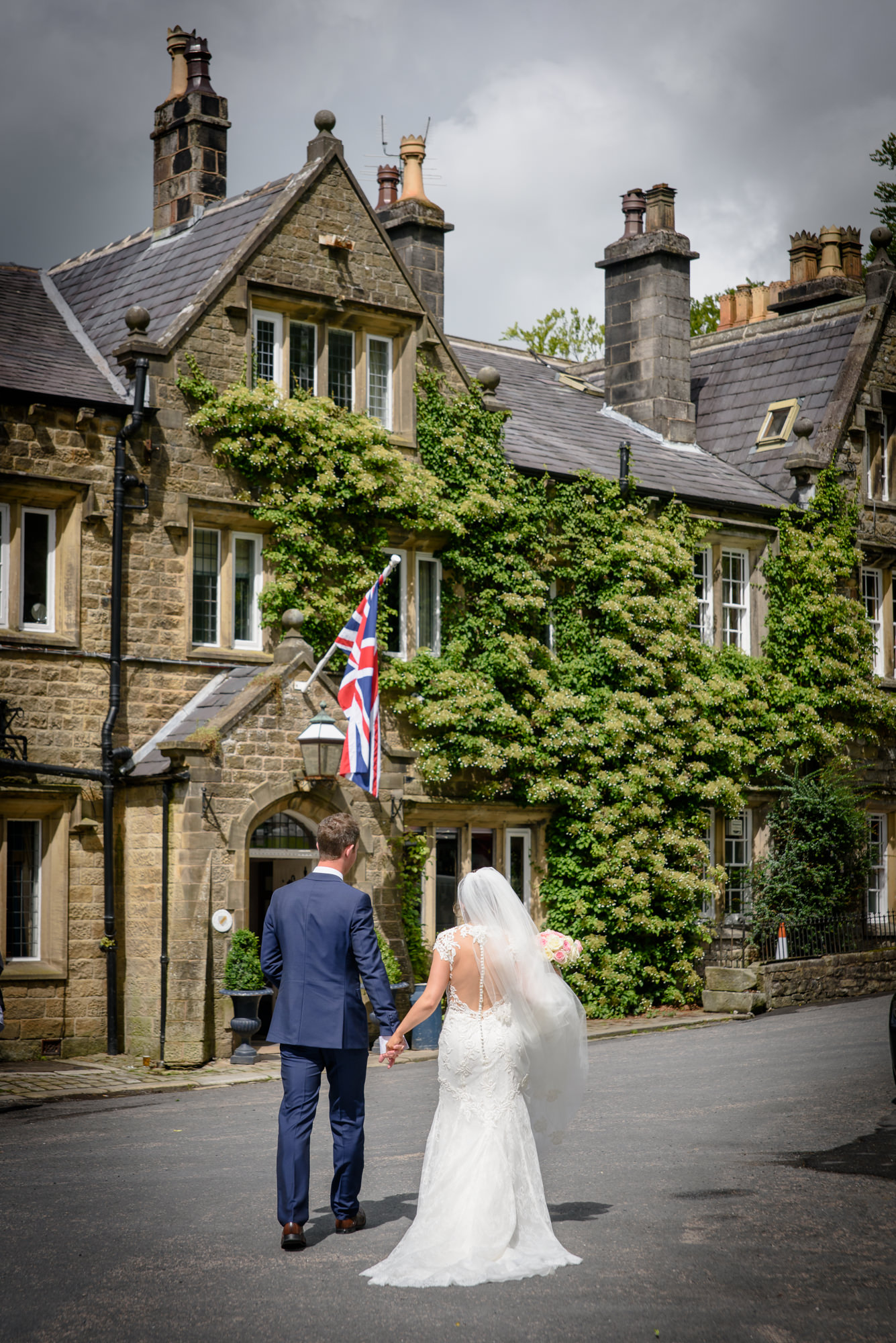 Bride and groom going to The inn at Whitewell