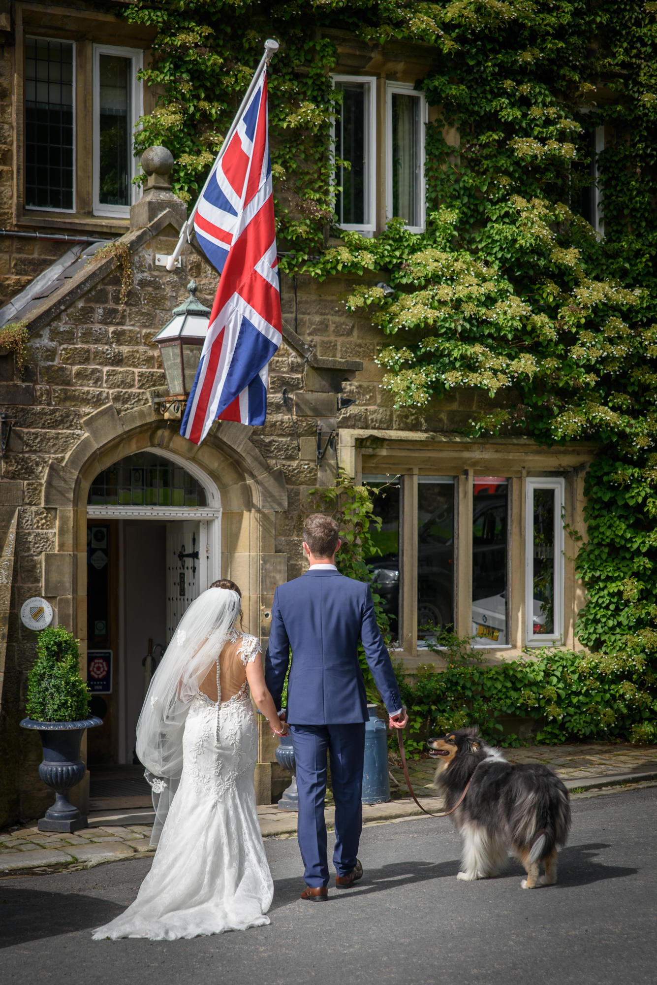 Bride and Groom walking the dog at The inn at Whitewell