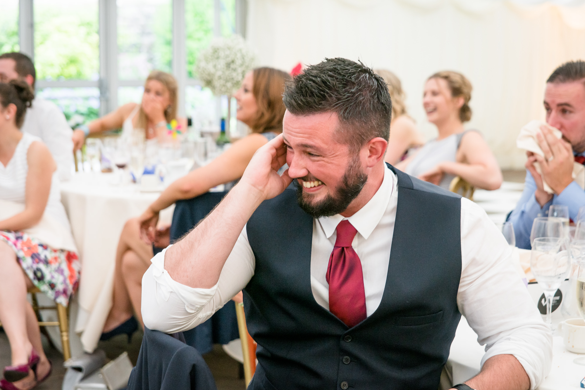 guest can't stop laughing during the speeches