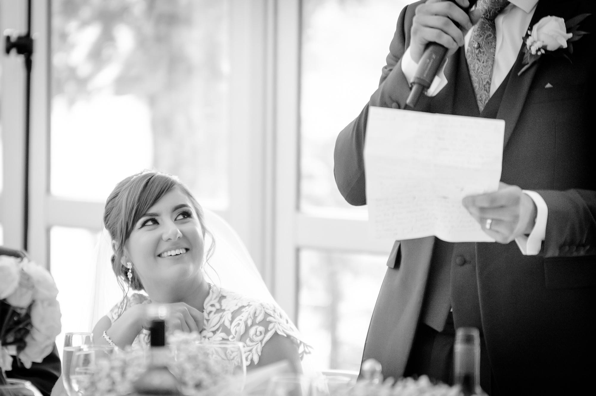 bride listening to the groom's speech