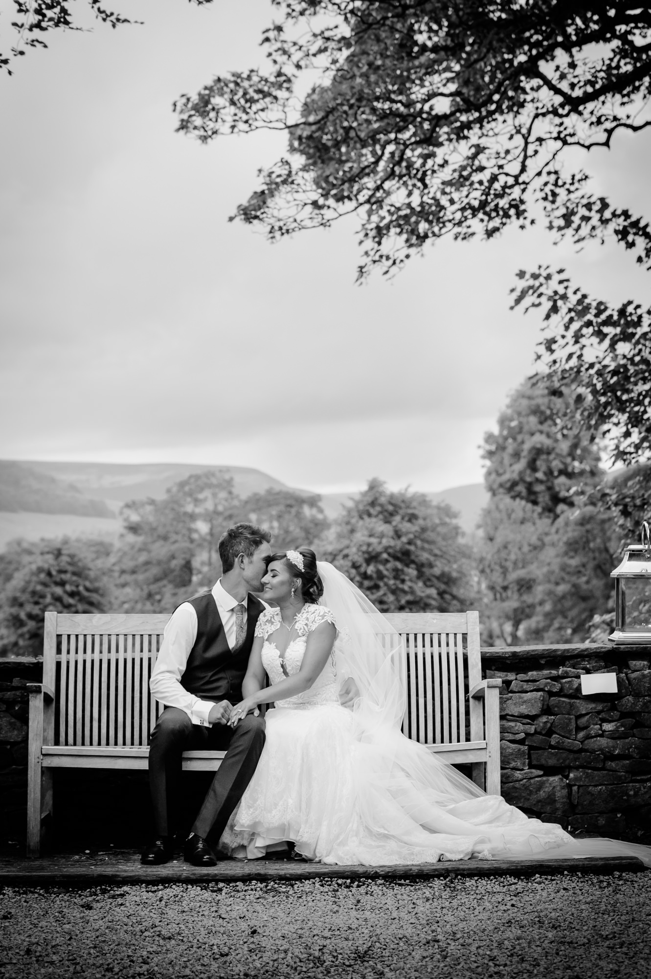 Bride and groom sitting outside at The inn at Whitewell