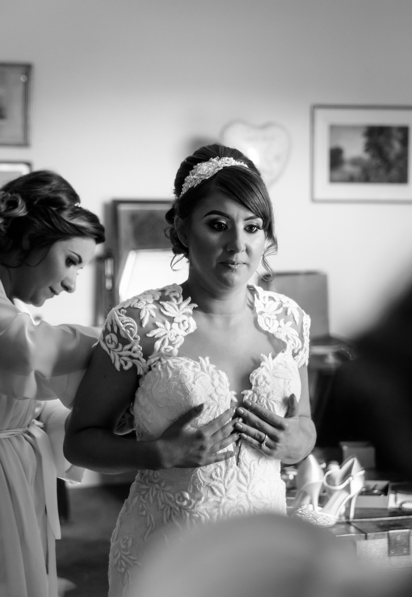 Bride getting ready at Bride dressing up her son at The inn at Whitewell