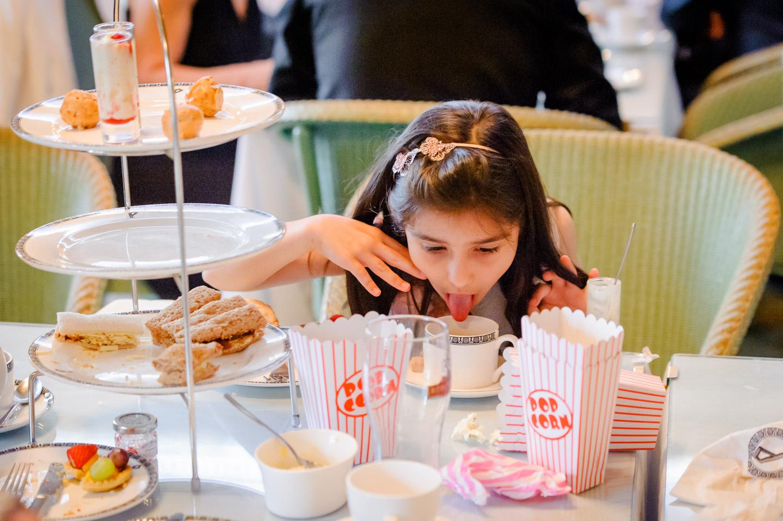 kid licking tea