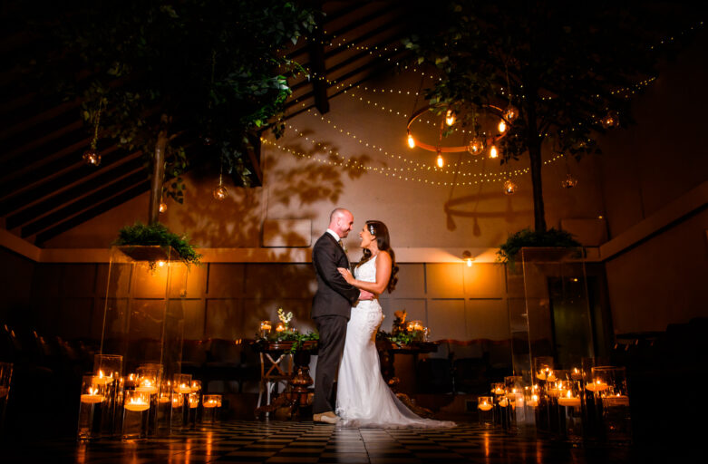 Bride and groom portrait in the ceremony room at Larkspur Lodge