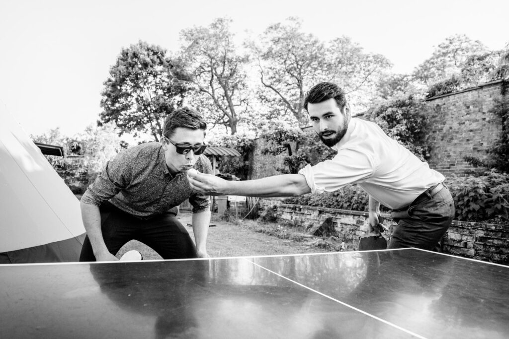 guests playing table tennis during the wedding