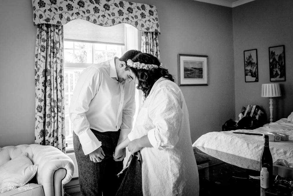 Bride and groom getting ready together at Talton Lodge