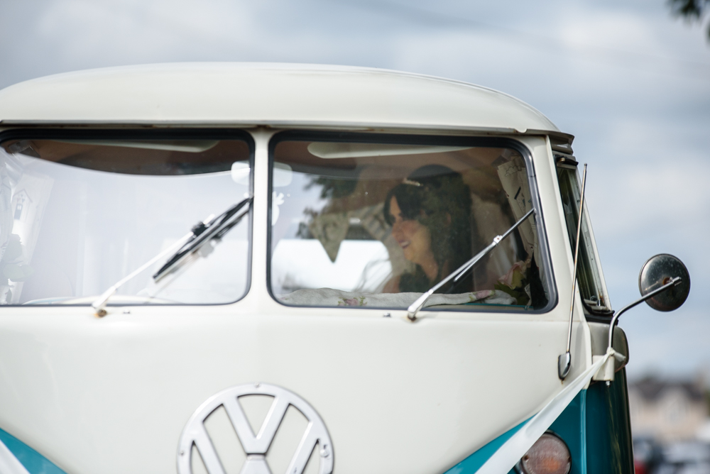 Bride arriving in a Camper van at the church
