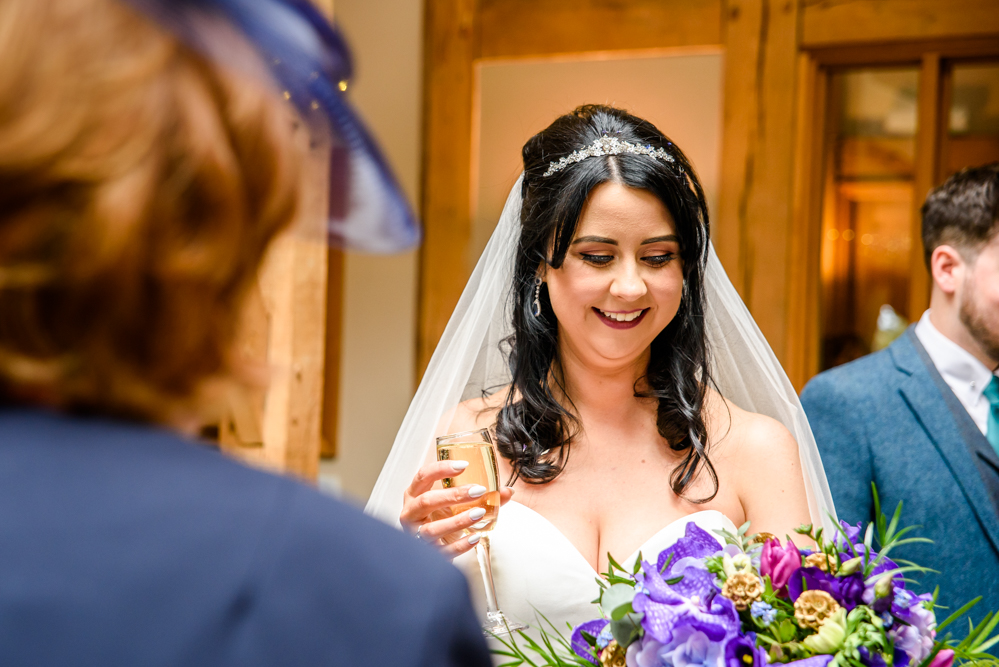 Bride during the drink reception at Oak Tree of Peover