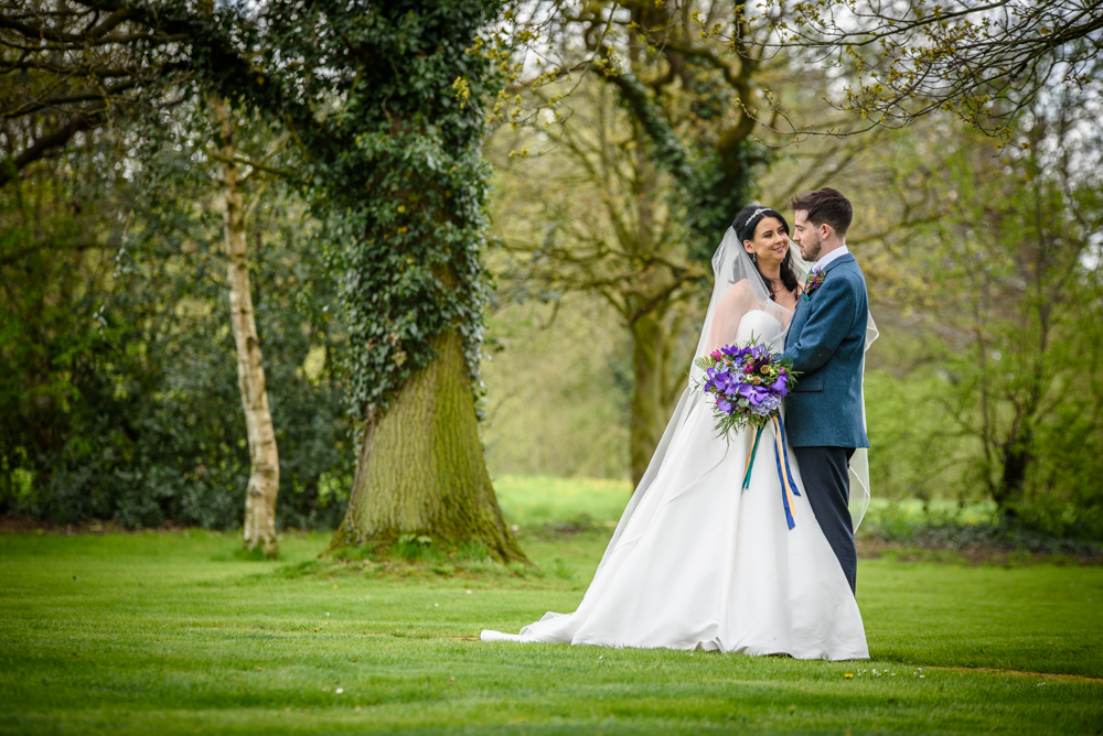 Bride and groom portrait at Oak Tree of Peover