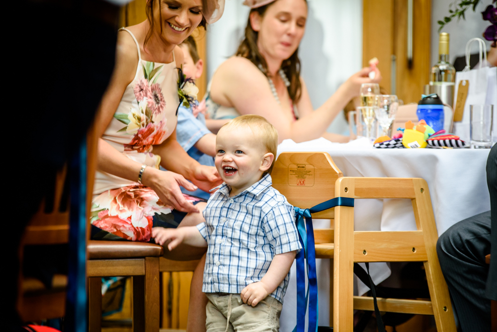 Toddler smiling during wedding reception at Oak Tree of Peover