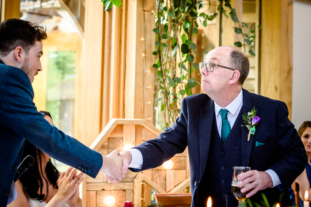 Father of the bride shaking the groom's hand at Oak Tree of Peover