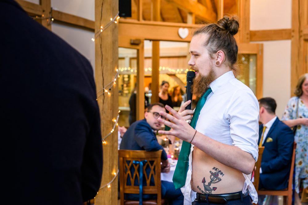 Best man reveal a tattoo with the groom's name on his belly at Oak Tree of Peover