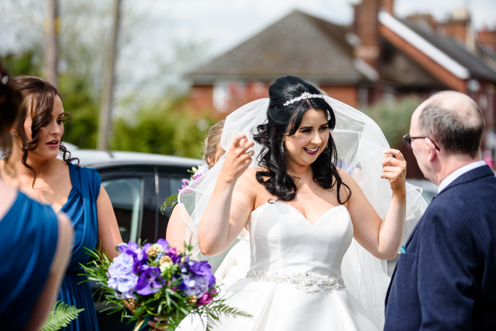 Bride arriving at the church St Mary's Church in Middlewich