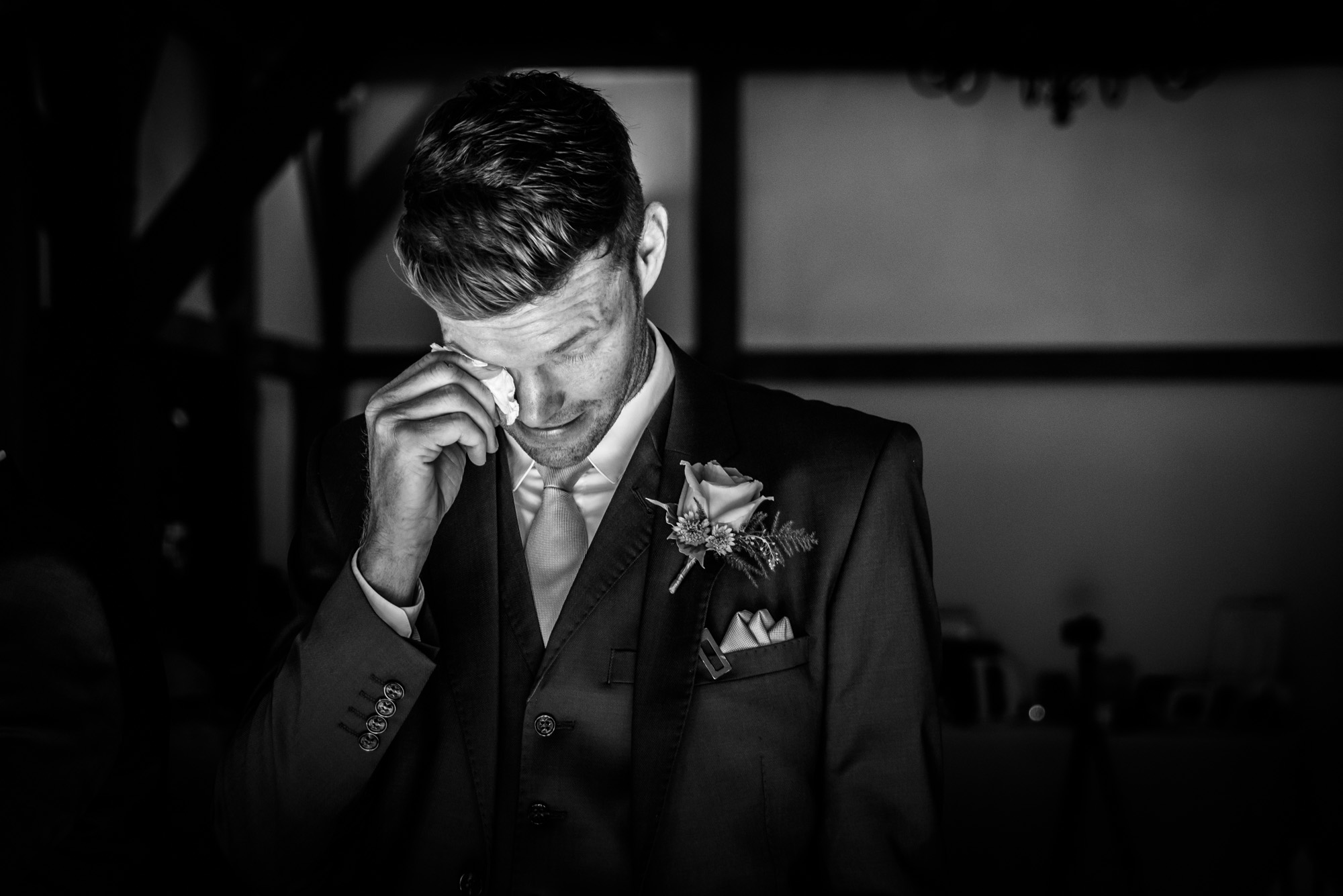 emotional groom waiting for the bride to arrive at Sandhole Oak Barn