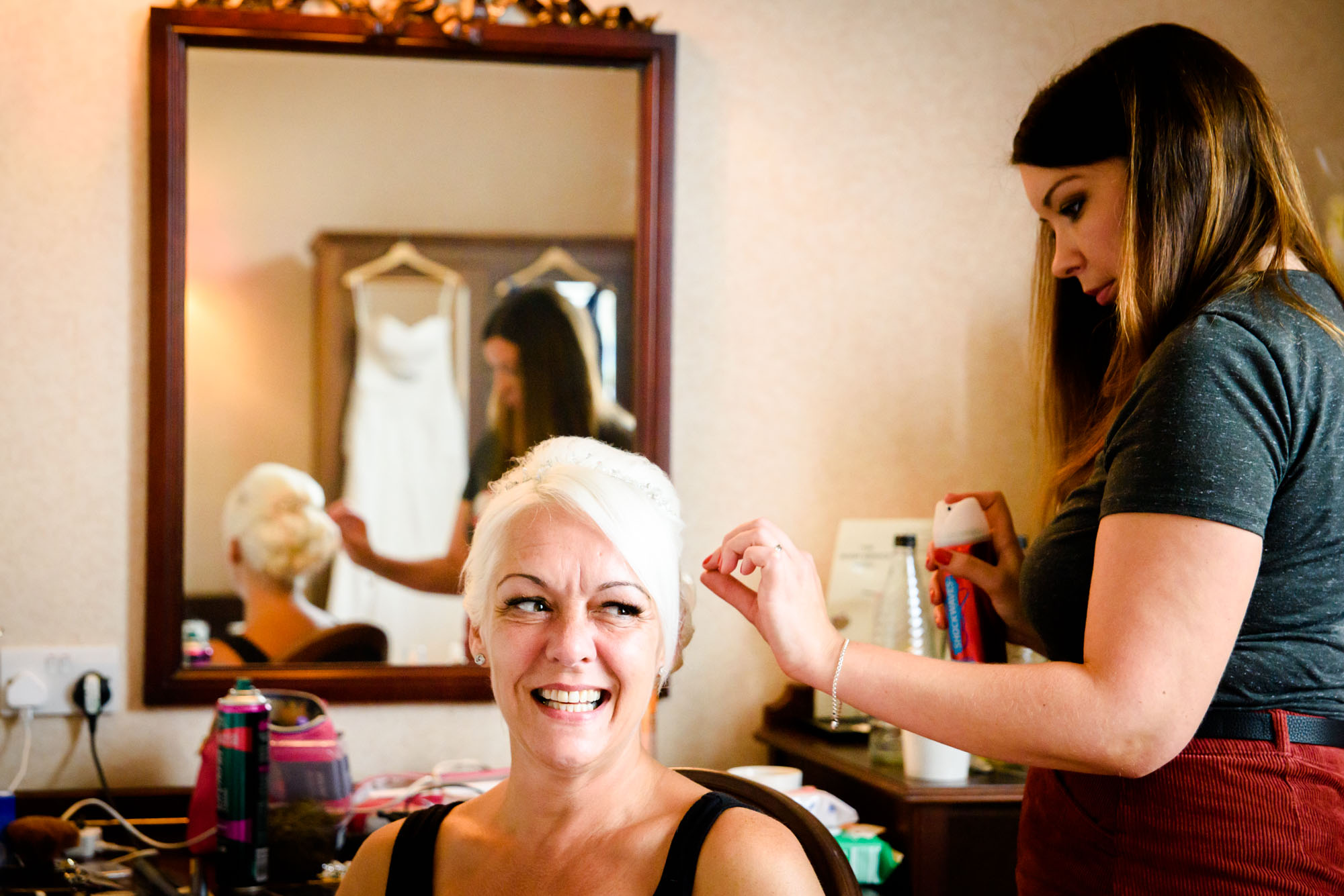 Bride having her hair done at Shrigley Hall
