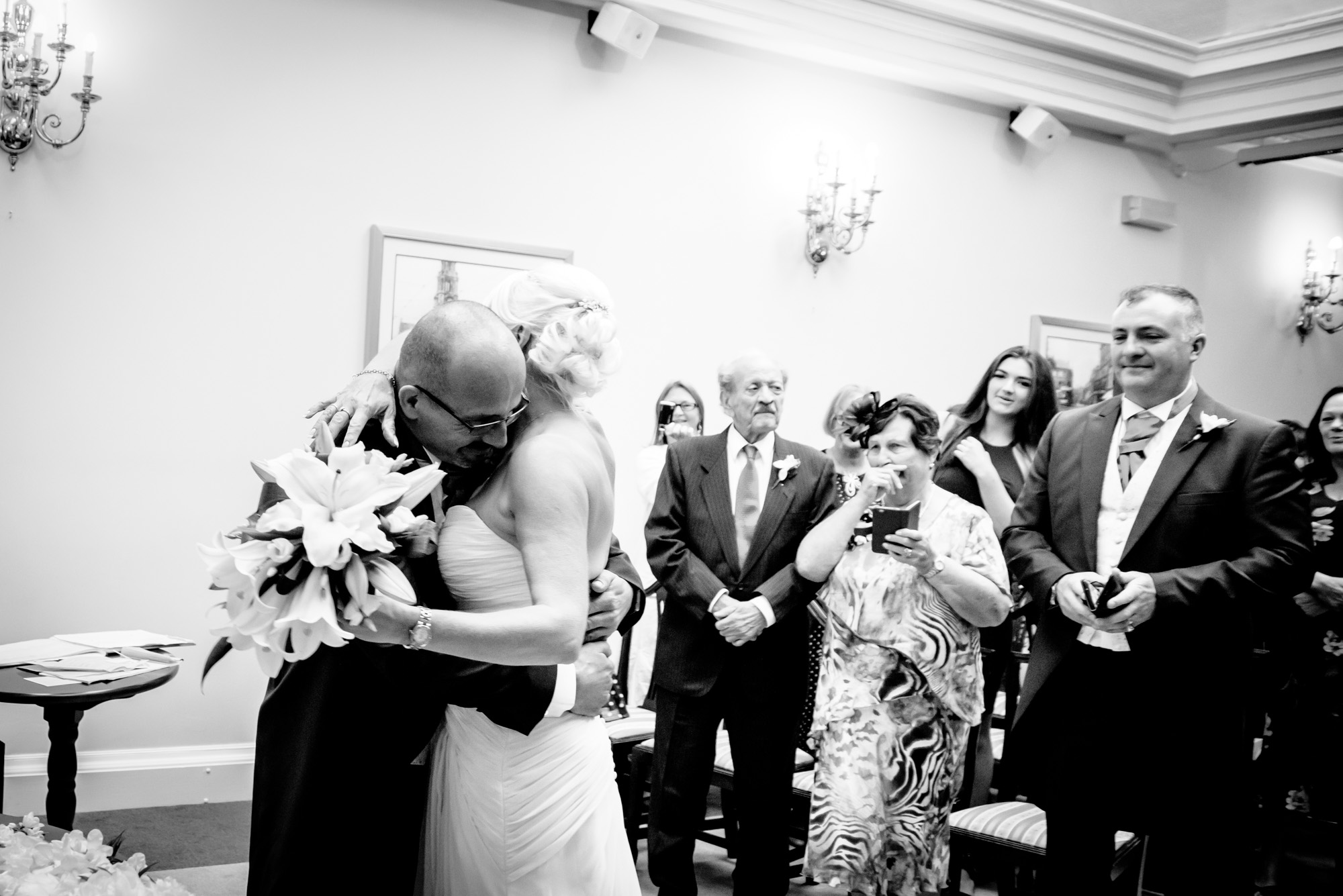 Bride and groom hugging at the beginning of the wedding ceremony in Stockport