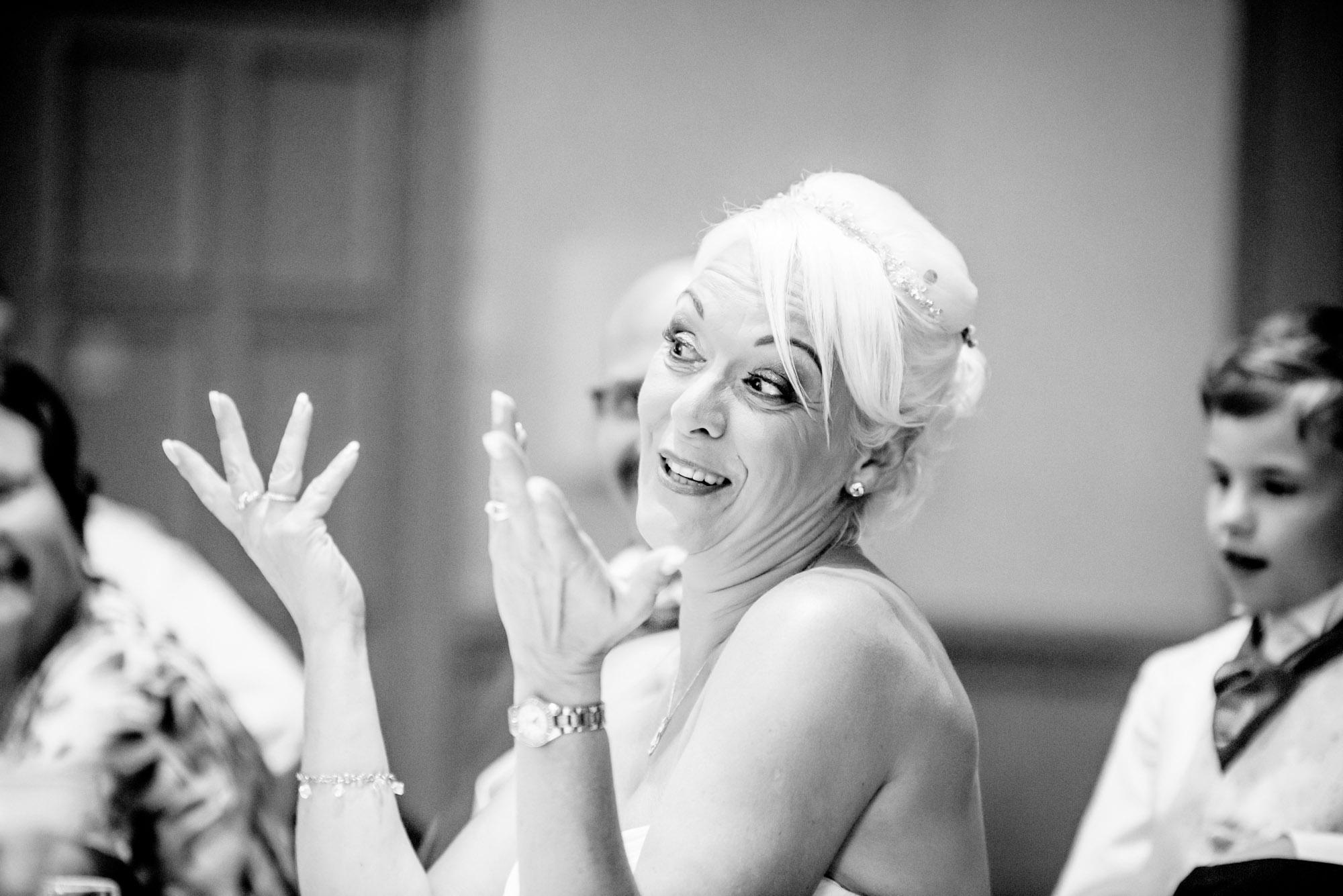 bride reacting to the groom's speech