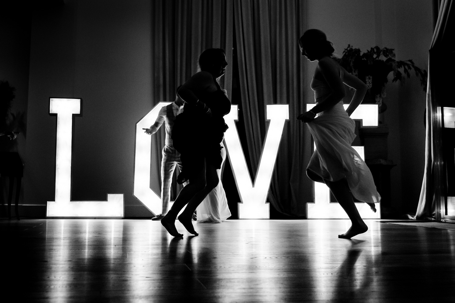 Dancing in front of the love letters