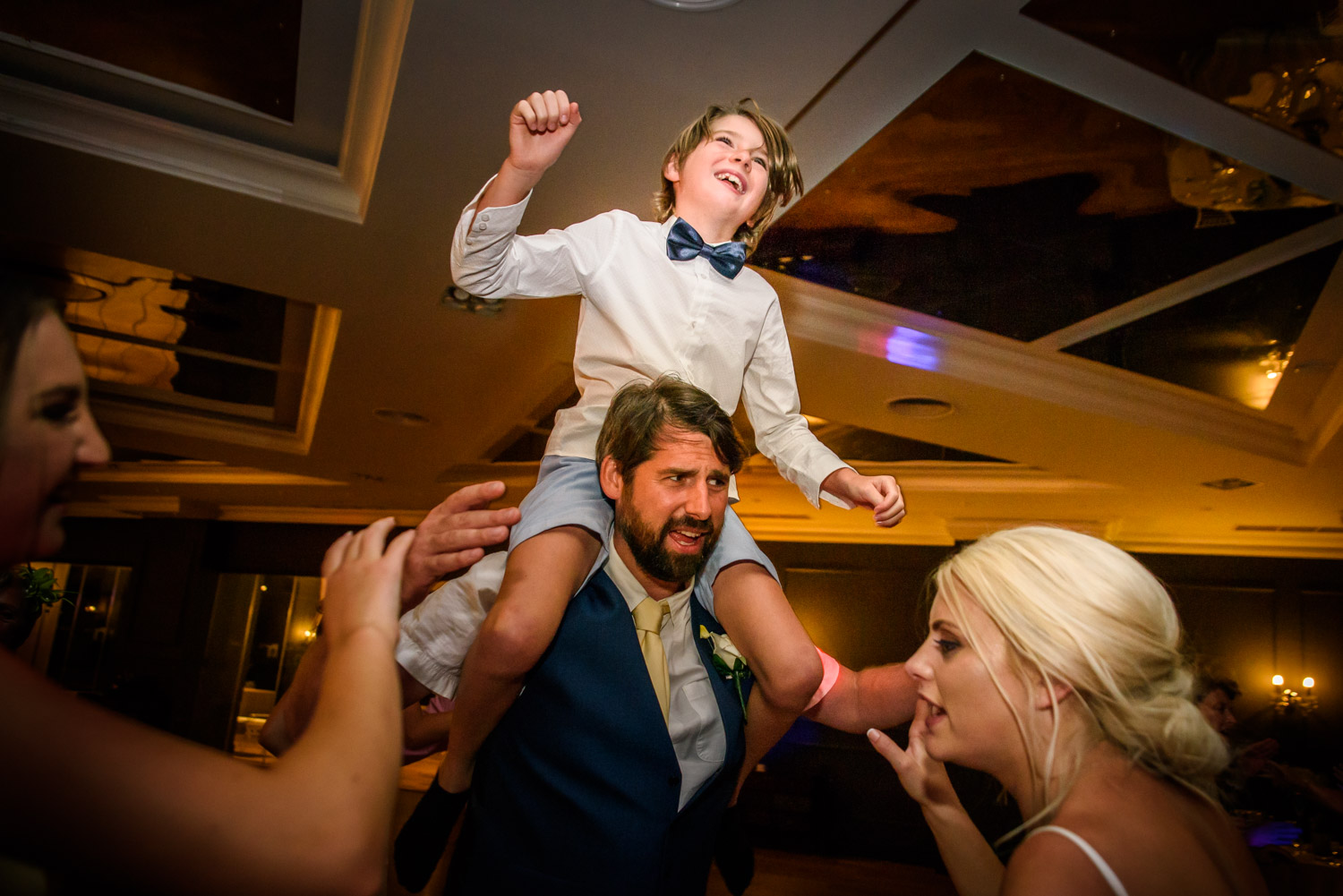 boy dancing on dad shoulders