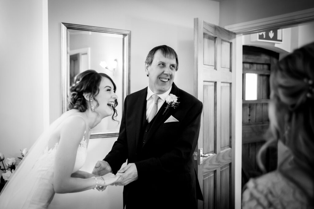 Dad and bride laughing