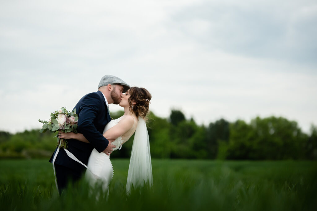 Kissing couple in a field