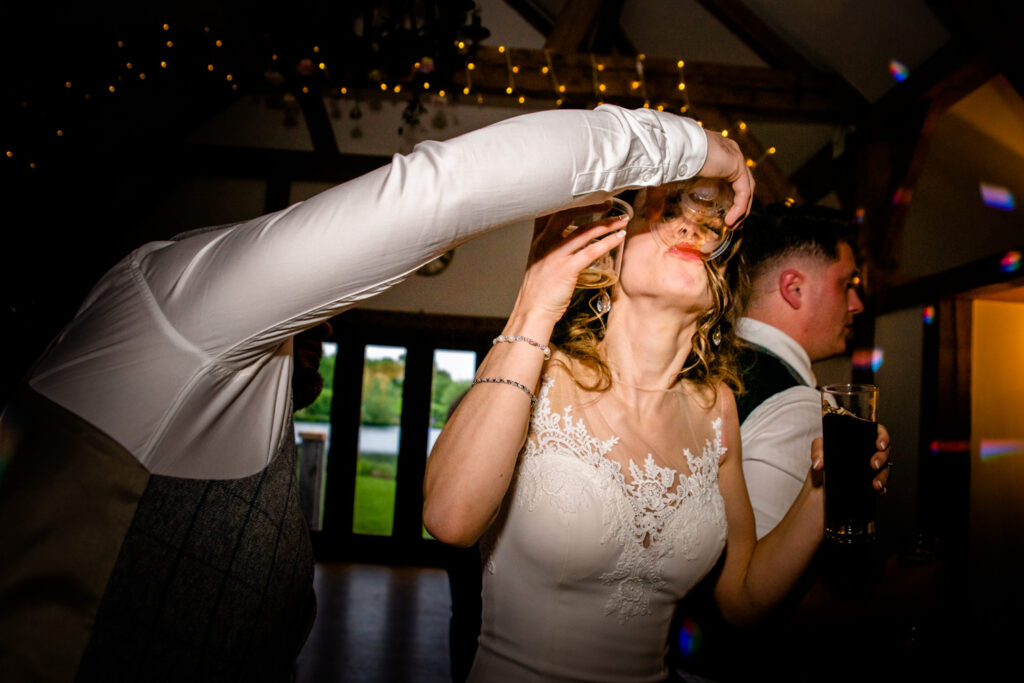 bride drinking shots on the dancefloor
