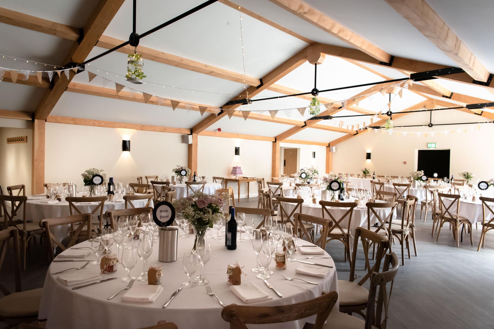 The Woodend Barn ready for the wedding breakfast at Hanbury wedding Barn