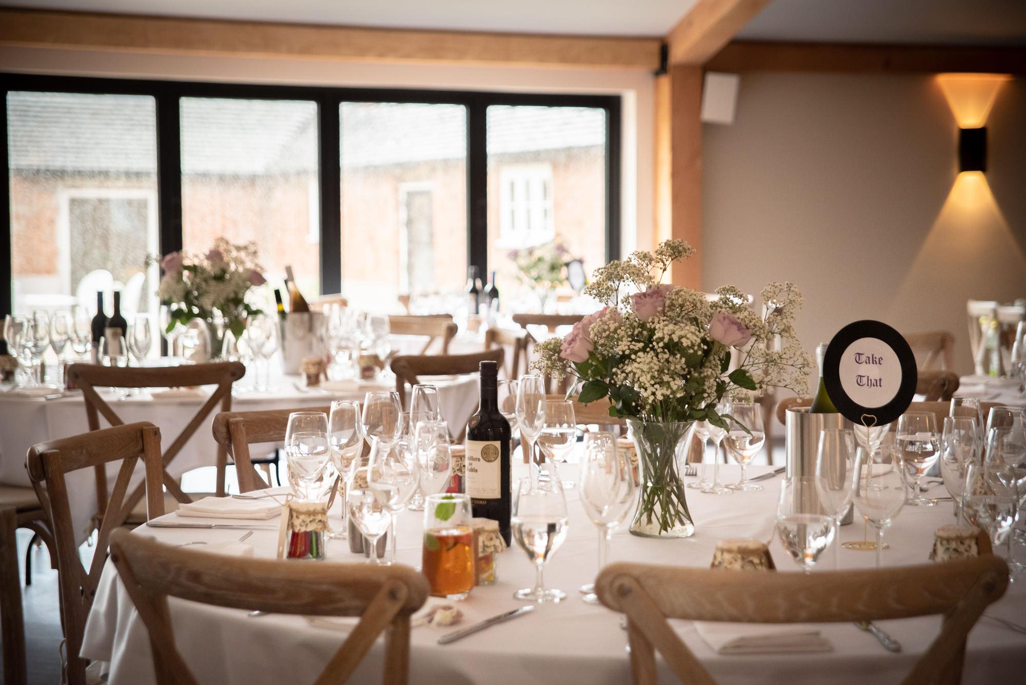 Wedding breakfast tables at Hanbury Wedding Barn