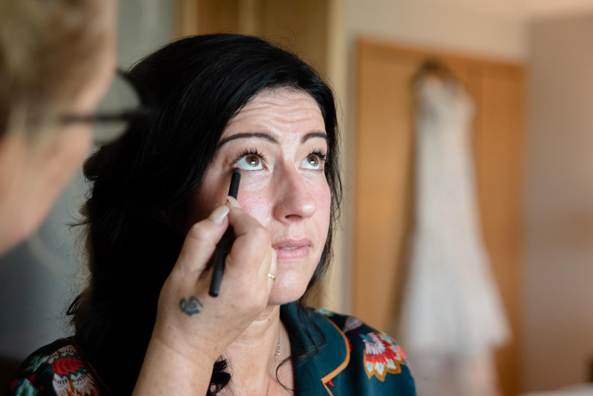 Bride having make up done.