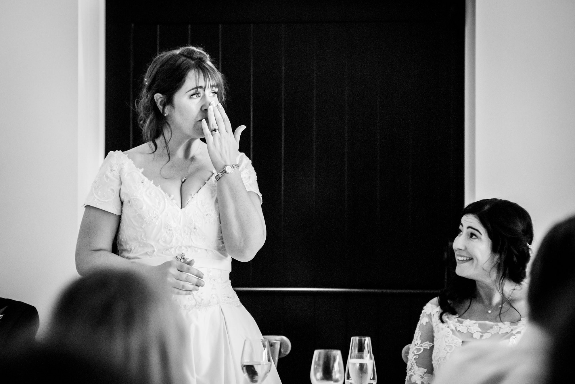 Bride getting emotional during the speeches